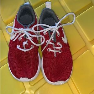 Red boys Nike shoes